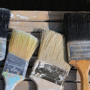 Clean hardened paint brushes